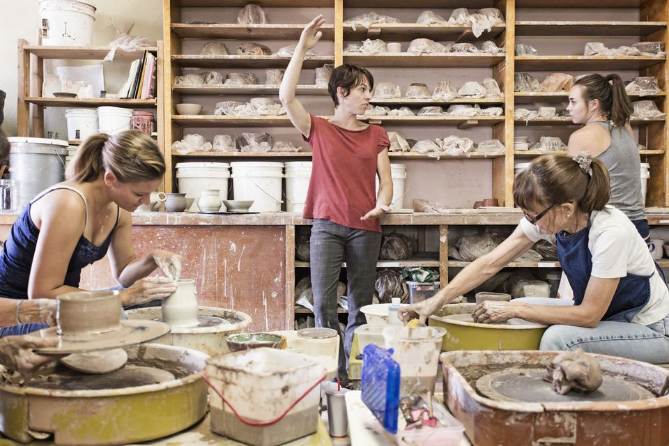 Students and teacher working in ceramic studio