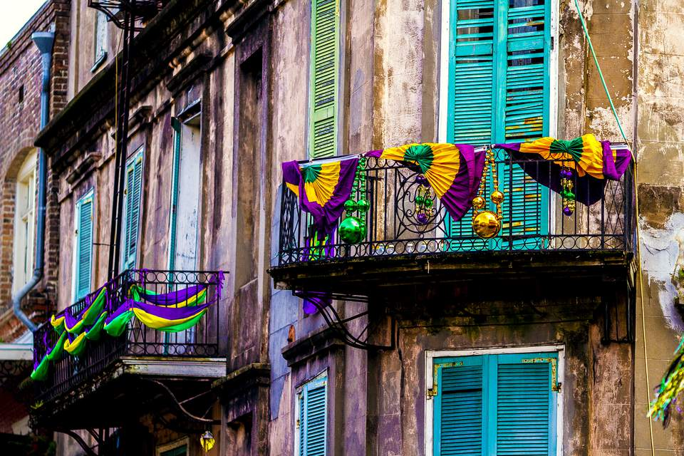 A building located in the French Quarter decorated for Mardi Gras