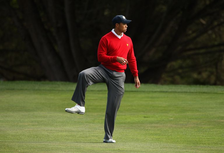 Tiger Woods stretches during a Presidents Cup match.