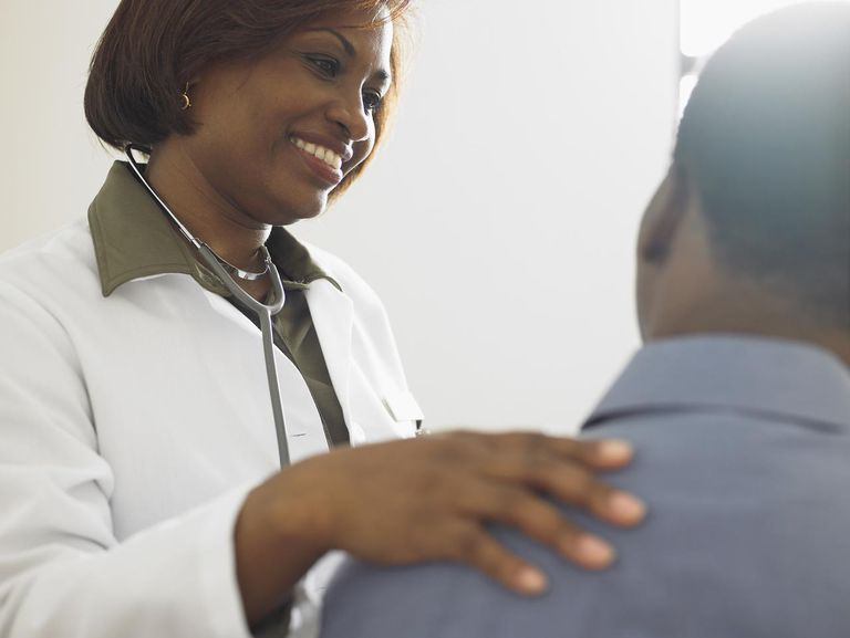 Female doctor talking to patient