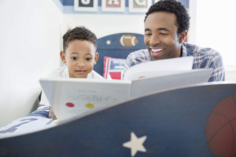 5 year old child development - father and son reading a book