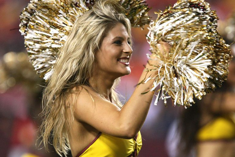 Cheerleader with gold pom poms