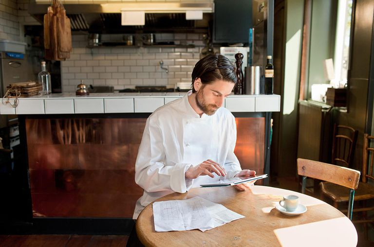 Chef using digital tablet in restaurant