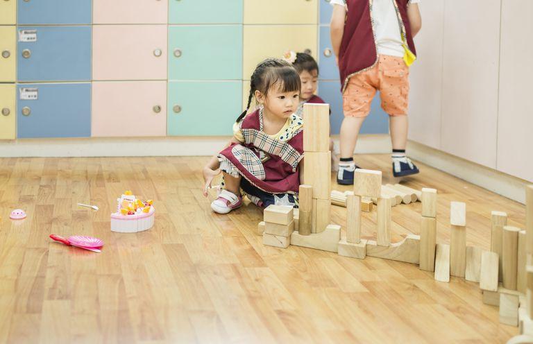 Kid playing toy building blocks