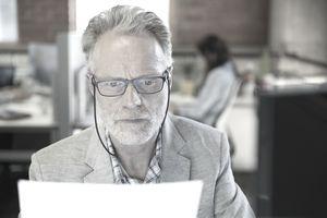 Focused businessman reading paperwork in office
