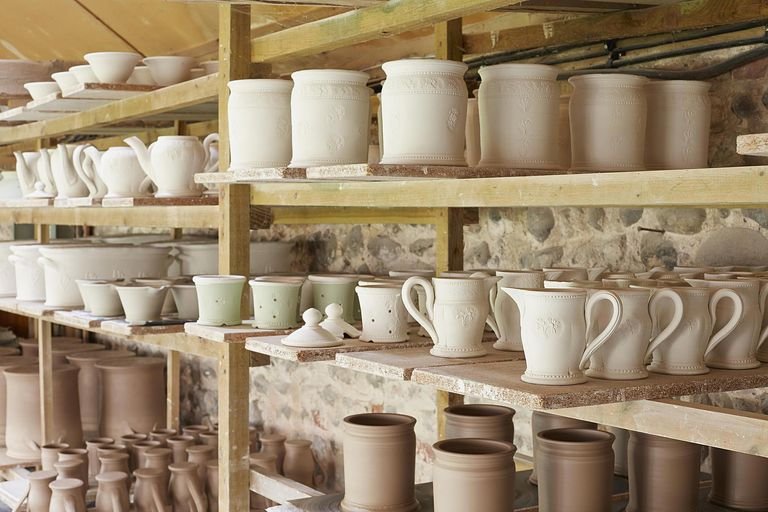 Boards of pottery in potters workshop