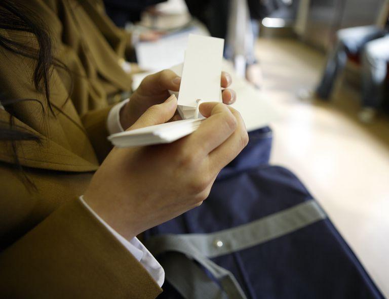 Schoolgirl Holding Flip Cards