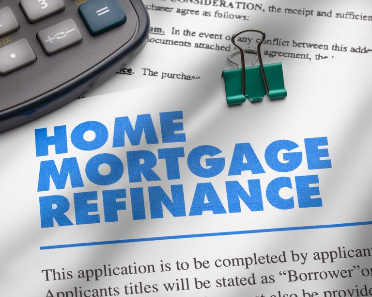 home mortgage refinance document next to calculator