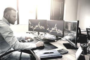 a man trading stocks on computer