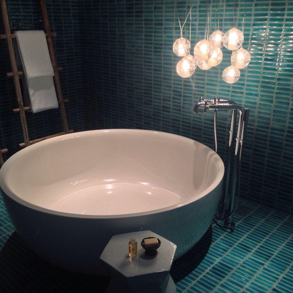dramatic aqua tile in the bathroom
