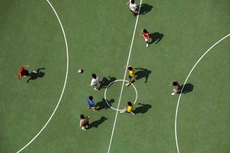 Aerial view of men playing soccer