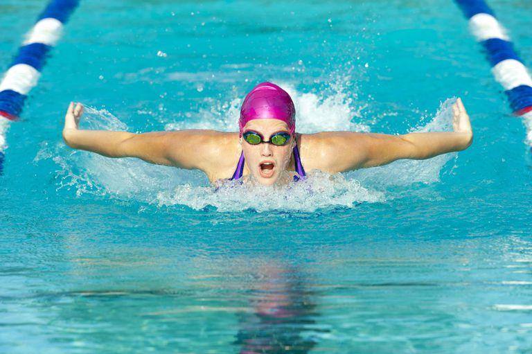 Butterfly swimmer in swimming lane