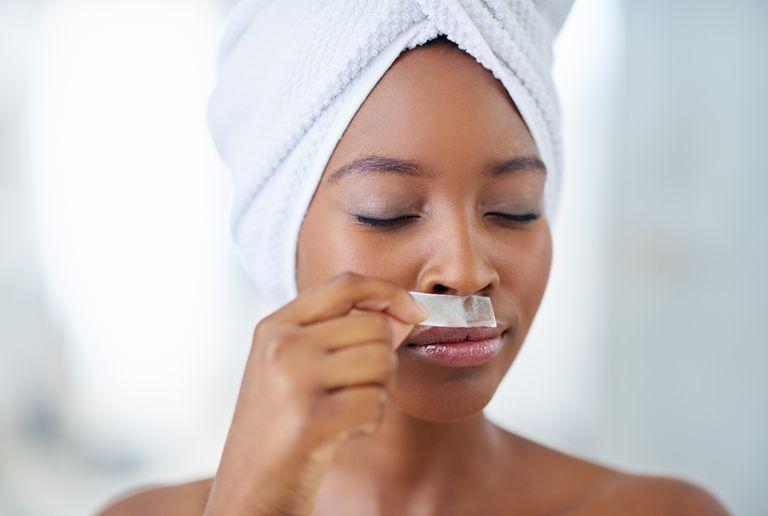 Woman waxing her lip