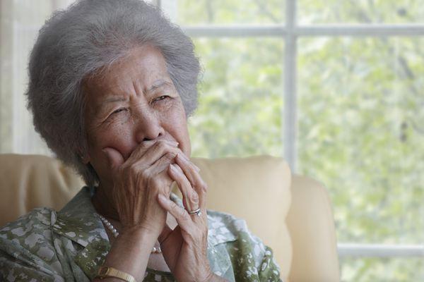 A Woman with Demenita Appears Tearful