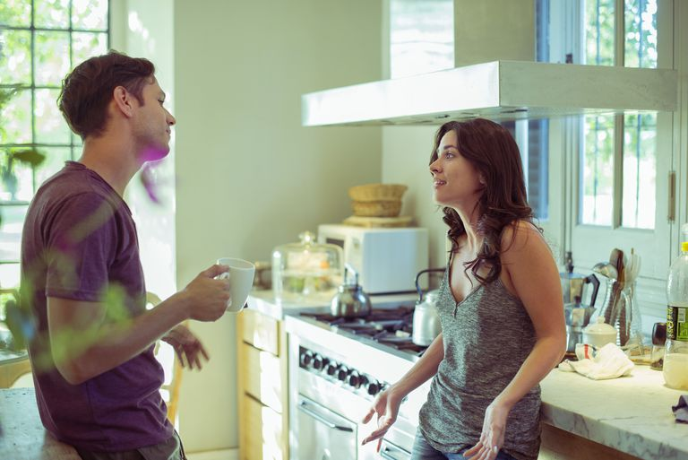 Arguing couple in a kitchen