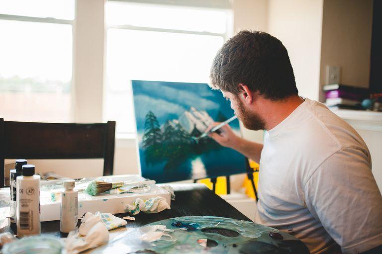 Man painting a landscape