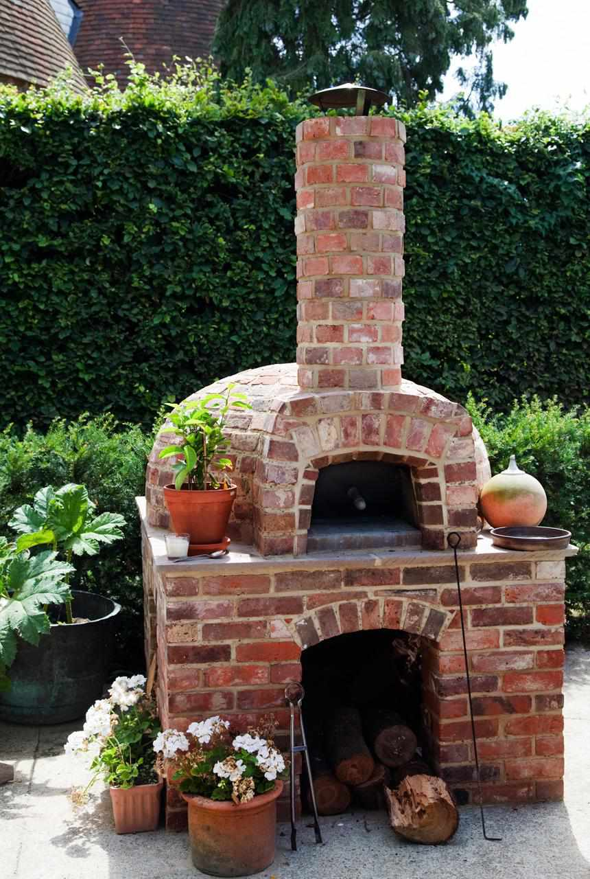 A brick wood-fired oven (pizza oven)