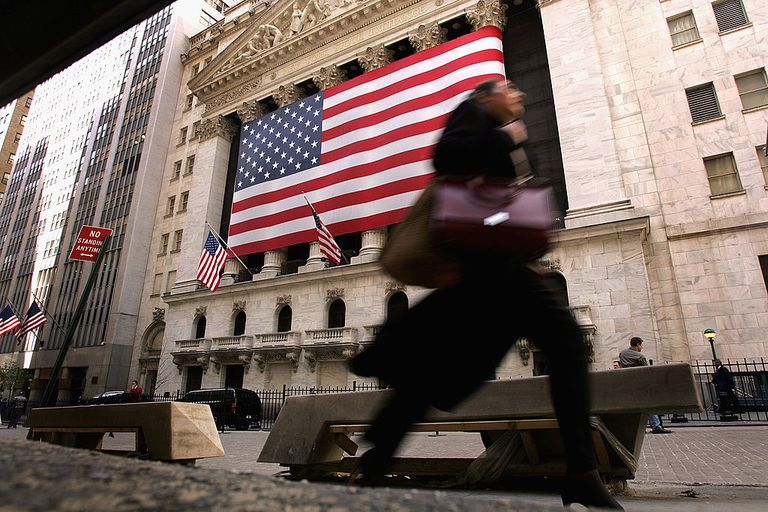 Woman walks past NYSE