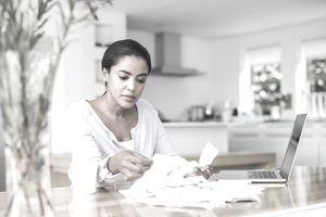 A woman reviews her bills