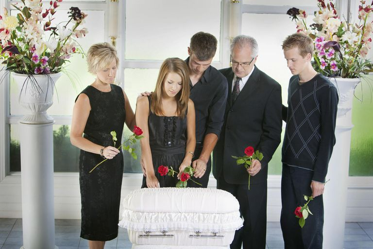 A Family Gathered Around An Infant's Coffin