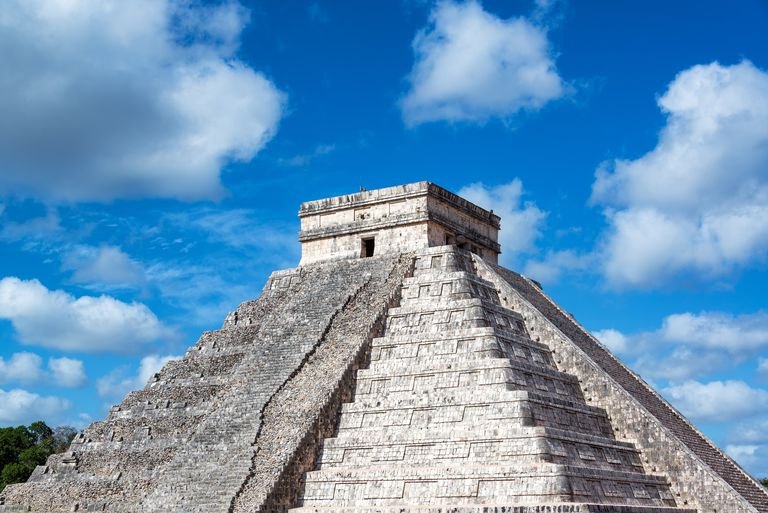 Low Angle View Of Kukulkan Pyramid Against Blue Sky During Sunny Day