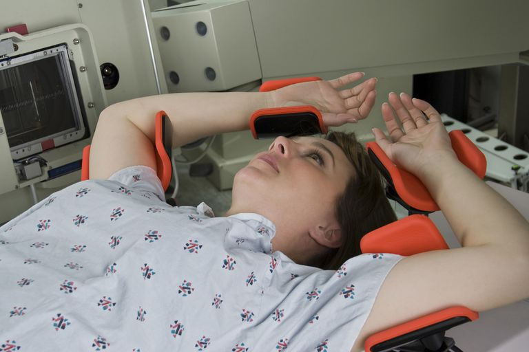 A woman undergoes radiation therapy.