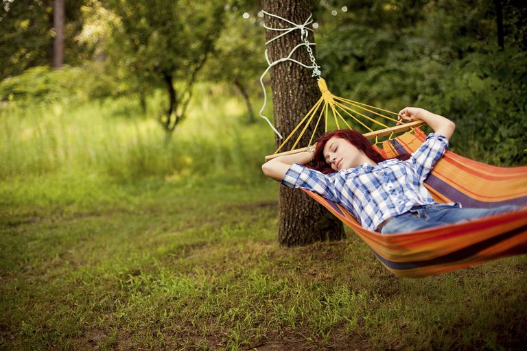 Woman napping in hammock