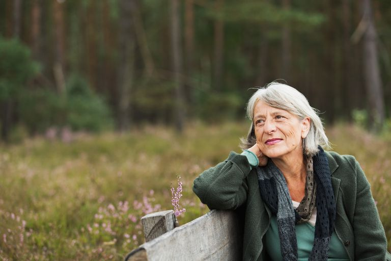 Senior woman on bench looking away