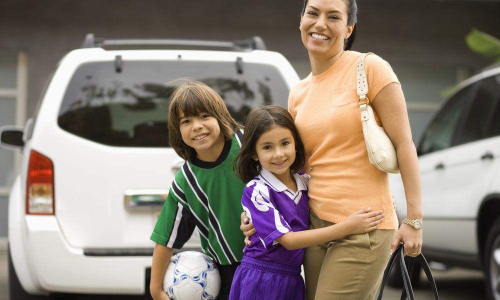 Mom with kids near minivan - sports parent burnout
