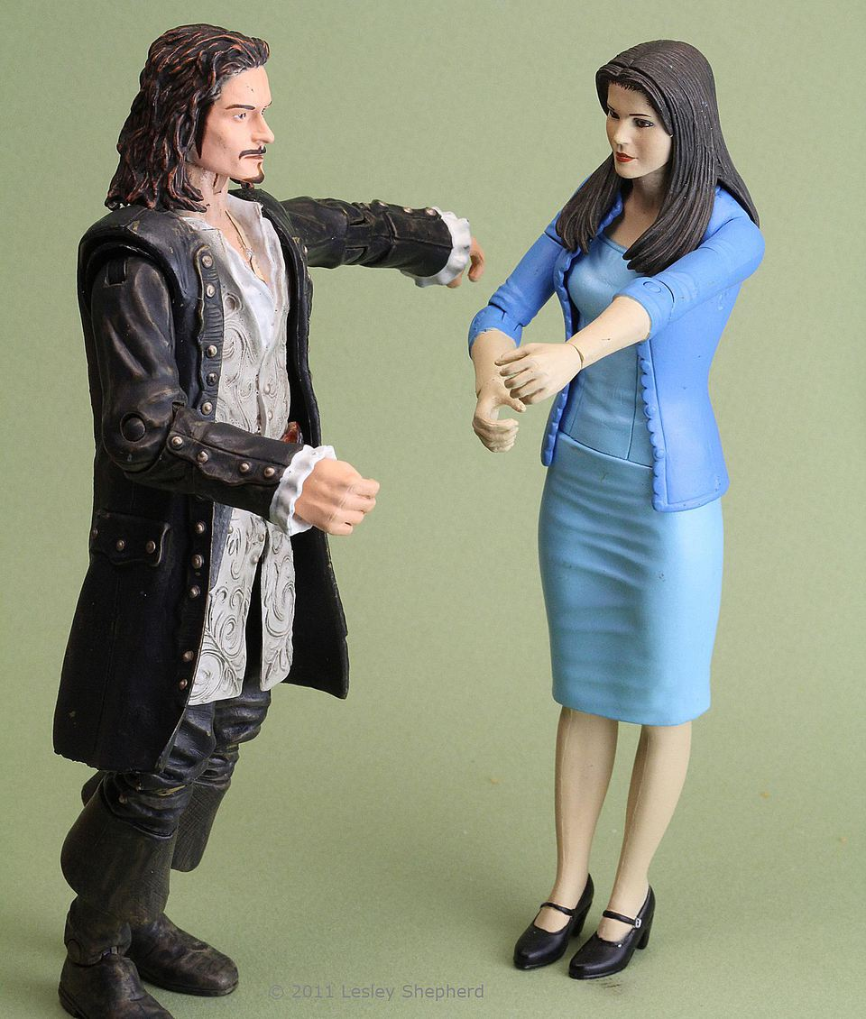 Range of articulation in two inexpensive action figures