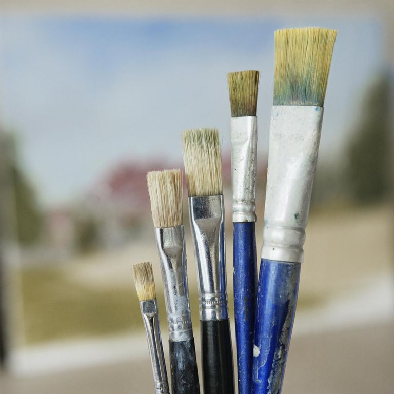 Paintbrushes in increasing height order, close-up