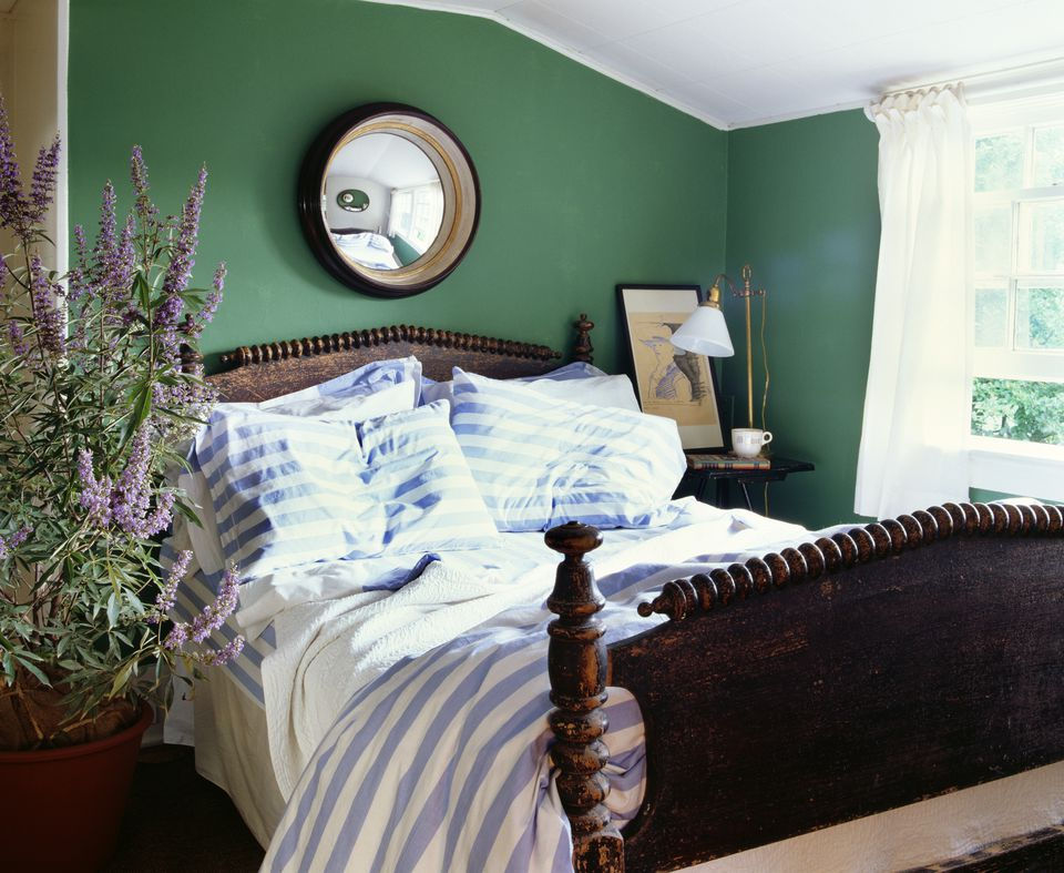 Rustic bedroom with green walls.
