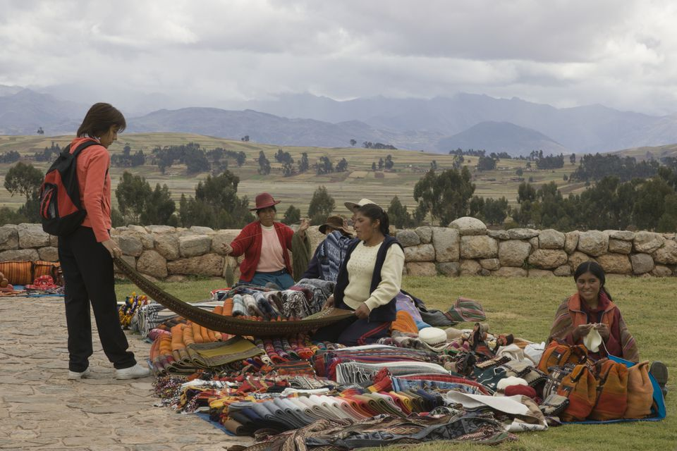 Tourist Shopping for Blankets at Rural Market