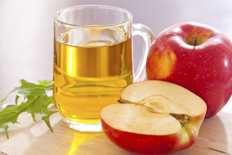 Apple cider vinegar with apples