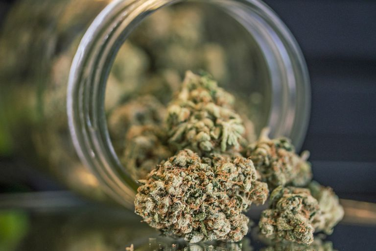 Close-Up Of Weed In Mason Jar On Table