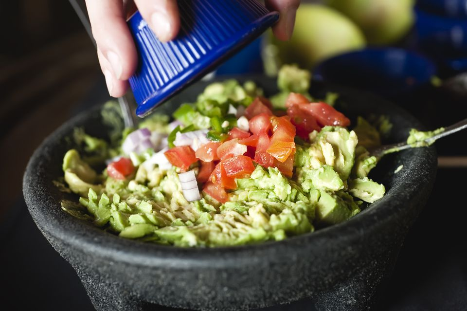 Making homemade guacamole