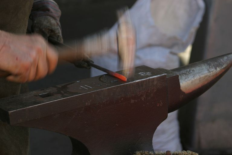 blacksmith shaping metal
