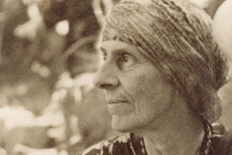 Historic sepia photo of Marion Mahony Griffin in her 60s, with head scarf