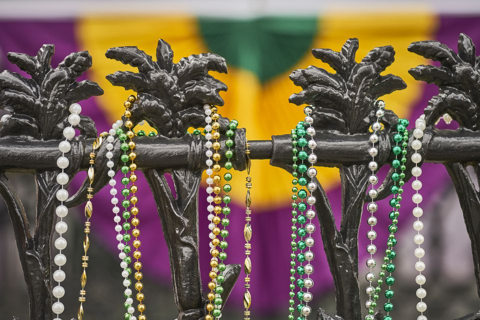 Mardi Gras beads on railing