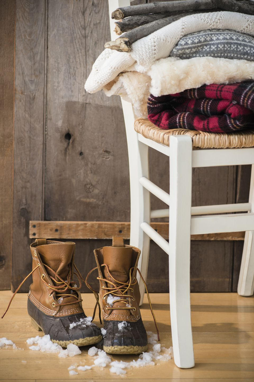 Studio Shot of snow boots and folded blankets