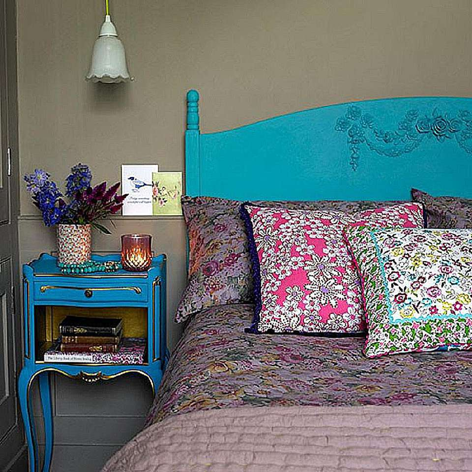 Mix pretty floral patterns in the bedroom.