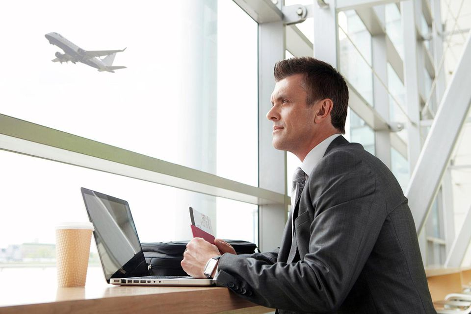 Businessman using laptop in airport