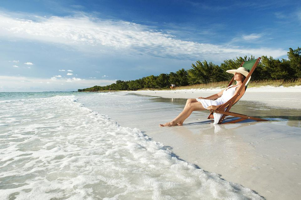 Woman relaxing on the beach alone