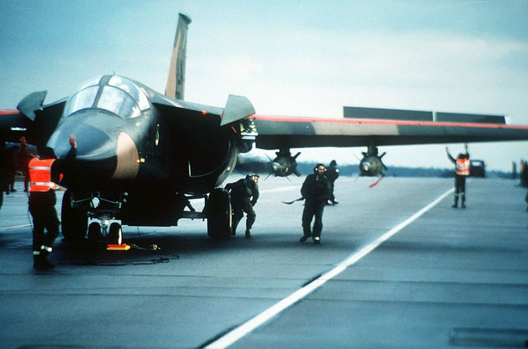 Ground crew prepares a 48th Tactical Fighter Wing F-111F aircraft for an air strike on Libya.