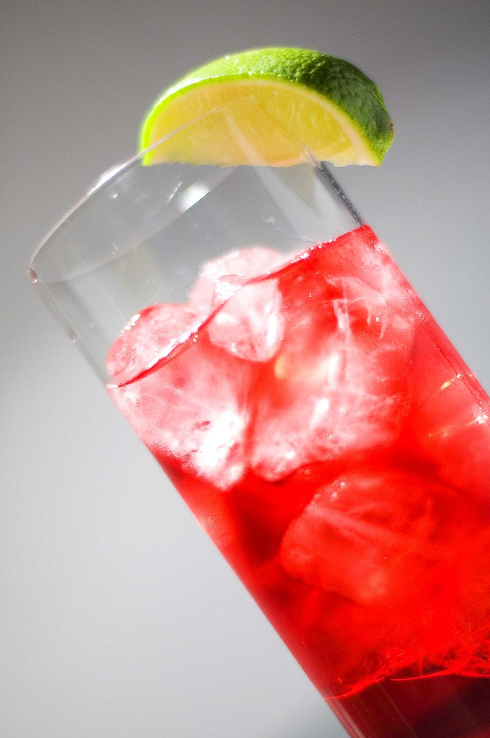 A woo woo cocktail with a lime garnish