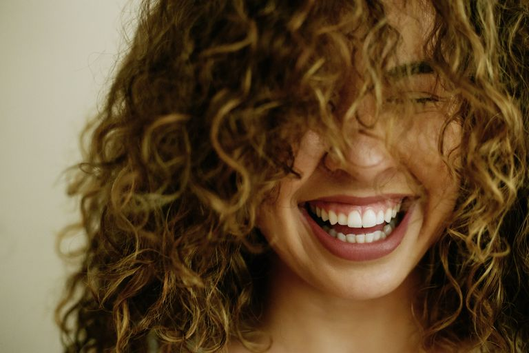 Portrait of laughing Mixed Race woman