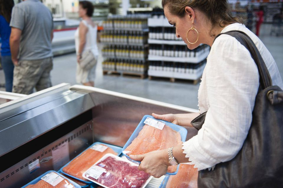 Buying fresh salmon at the grocery store