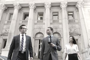 Business people in front of New York State Courthouse