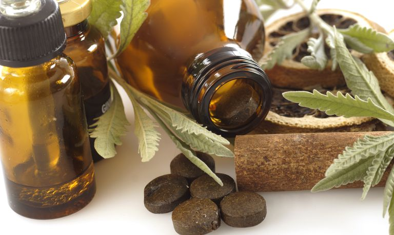 Pill bottles with licorice plants and homeopathic medicine