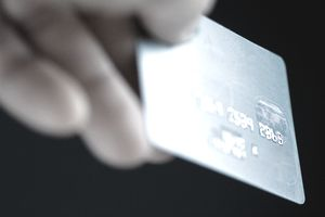 Close-up of a persons fingers holding a credit card